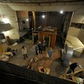 Visitors take a look around the old opera house on the second floor of the old Dixieland Shoes store...