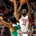 Arkansas forward Marshawn Powell (right), who finished with 21 points and 10 rebounds in Tuesday's 8...