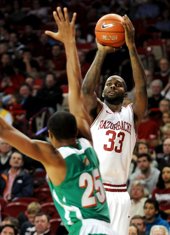 Arkansas forward Marshawn Powell (right), ...