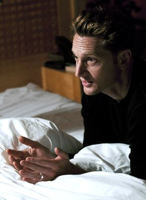 We're showing you this picture of 28 Hotel Rooms director Matt Ross making a point to his cast at L'Ermitage Beverly Hills because all of the other available promotional photos contained naked bodies.
