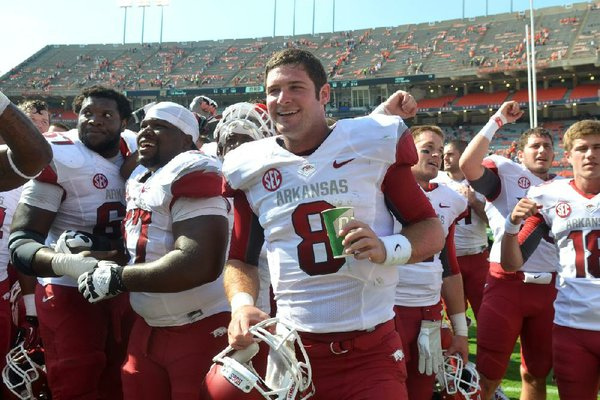 Gene Chizik's Auburn Tigers had all the momentum from a national championship season and the accompanying exposure, and stockpiled highly rated recruits to keep the success going. The Tigers were beaten 24-7 by a struggling Razorbacks team and then things got even worse. Shown University of Arkansas quarterback Tyler Wilson celebrates with his team following the Razorbacks win over Auburn.