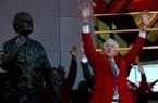 NWA Media/JASON IVESTER -- Frank Broyles calls the Hogs during an unveiling ceremony for the new statue representing him outside the Broyles Athletic Center on Friday, Nov. 23, 2012, at Donald W. Reyonlds Stadium in Fayetteville.