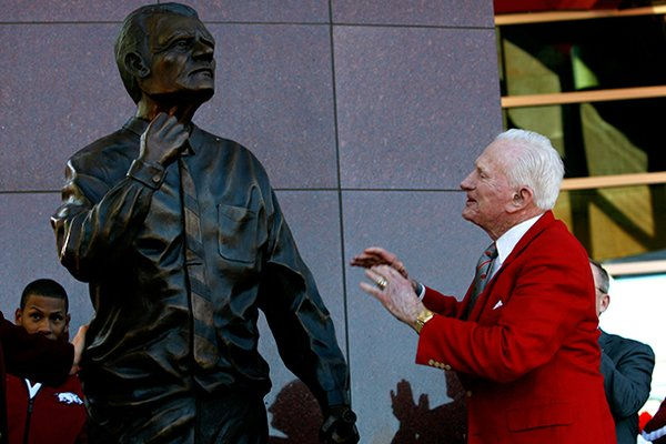 NWA Media/JASON IVESTER -- Frank Broyles admires the statue representing him during an unveiling ceremony outside the Broyles Athletic Center on Friday, Nov. 23, 2012, at Donald W. Reyonlds Stadium in Fayetteville.