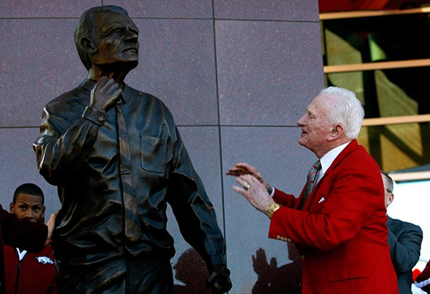 nwa-mediajason-ivester-frank-broyles-admires-the-statue-representing-him-during-an-unveiling-ceremony-outside-the-broyles-athletic-center-on-friday-nov-23-2012-at-donald-w-reyonlds-stadium-in-fayetteville