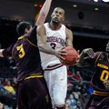 Arkansas' Rickey Scott (3) drives to the basket between Arizona State's Eric Jacobsen (3) and Carric...