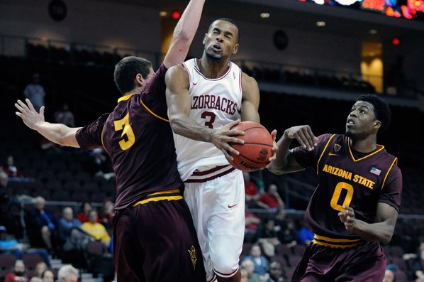 Arkansas' Rickey Scott (3) drives ...