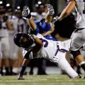 Heath McCracken, a Fayetteville strong safety, upends Rogers High senior running back Zachary Raphae...