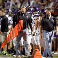 David Hook, left, and Todd Hook walk down the sideline to move the first down measuring chain and st...