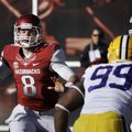 Arkansas quarterback Tyler Wilson (8) passes over LSU defensive end Sam Montgomery (99) as Arkansas ...