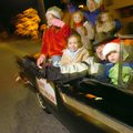 Former Springdale Mayor Jerre Van Hoose waves from a classic car during a previous Christmas parade....