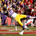 NWA Media/JASON IVESTER -- LSU wide receiver Jarvis Landry makes a catch for a touchdown in front of...