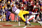 NWA Media/JASON IVESTER -- LSU wide receiver Jarvis Landry makes a catch for a touchdown in front of Arkansas linebacker Otha Peters during the second quarter on Friday, Nov. 23, 2012, at Donald W. Reynolds Razorback Stadium in Fayetteville.