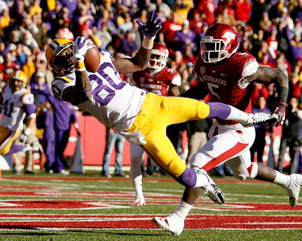 nwa-mediajason-ivester-lsu-wide-receiver-jarvis-landry-makes-a-catch-for-a-touchdown-in-front-of-arkansas-linebacker-otha-peters-during-the-second-quarter-on-friday-nov-23-2012-at-donald-w-reynolds-razorback-stadium-in-fayetteville