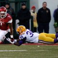 NWA Media/JASON IVESTER -- Arkansas running back Knile Davis slips past a tackle attempt from LSU sa...