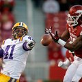 Arkansas linebacker Terrell Williams (right) breaks up a pass intended for Louisiana State tight end...