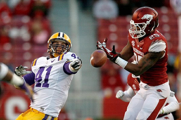 Arkansas linebacker Terrell Williams (right) breaks up a pass intended for Louisiana State tight end Travis Dickson during the fourth on Friday, Nov. 23, 2012, at Donald W. Reynolds Razorback Stadium in Fayetteville.