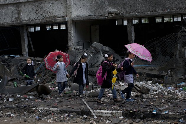 palestinian-schoolchildren-walk-in-debris-by-a-damaged-school-in-gaza-city-saturday-nov-24-2012-schools-in-gaza-opened-saturday-for-the-first-time-since-the-truce-which-calls-for-an-end-to-gaza-rocket-fire-on-israel-and-israeli-airstrikes-on-gaza-came-after-eight-days-of-cross-border-fighting-the-bloodiest-between-israel-and-hamas-in-four-years-the-school-was-damaged-when-israeli-forces-struck-on-a-nearby-building