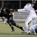 Tearris Wallace, left, a Bentonville senior running back, eludes the grasp of Fort Smith Southside s...