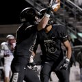 Cody Scroggins, left, a Bentonville sophomore, celebrates a second quarter touchdown with senior Kal...