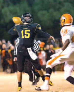 Cooper Winters, Prairie Grove quarterback, throws Friday during the Class 4A playoff game against Nashville at Tiger Stadium in Prairie Grove.