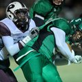 Calvin Jones, Greenland running back, is brought down Friday by Prescott defender Mark Johnson in th...