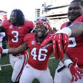 Georgia running back Todd Gurley (3), fullback Alexander Ogletree (46), and guard Mark Beard (79) ce...