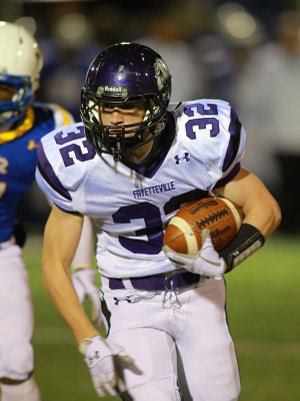 Cole Harris, Fayetteville, runs for a touchdown Friday in the first half against North Little Rock.