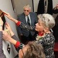 Ann Roberts, center, hangs a plaque dedicating The Rev. Dr. Maurice E. Roberts Chapel on Nov. 16 at ...