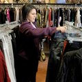 Jill Bennett of Pratt, Kan., looks through racks Friday at Fleur de Lis n Rogers.