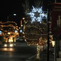 Christmas decorations hang Friday from poles along Emma Avenue in Springdale. The city changed out m...