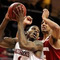 Arkansas' Coty Clarke (4) looks to make a shot with Wisconsin's Ryan Evans (5) defending during the ...