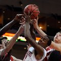 From left to right, Arkansas' Marshawn Powel, Wisconsin's Frank Kaminsky, Arkansas' BJ Young and Wis...
