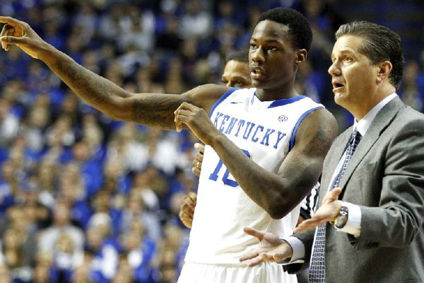 Kentucky's Archie Goodwin, left, speaks with head coach John Calipari during the second half of an NCAA college basketball game against LIU Brooklyn at Rupp Arena in Lexington, Ky., Friday, Nov. 23, 2012. Kentucky won 104-75. (AP Photo/James Crisp)