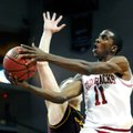 Arkansas' BJ Young (11) drives to the basket with Arizona State's Jonathan Gilling defending during ...