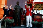 Former Arkansas Coach and Athletic Director Frank Broyles calls the Hogs on Friday during a ceremony unveiling a statue in his honor outside the Broyles Athletic Center in Fayetteville.