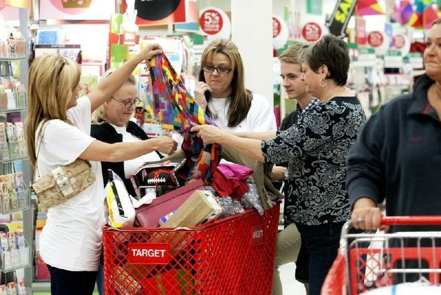 debby-blankenship-from-left-terri-cole-christy-organ-blake-organ-and-flora-blankenship-sort-through-their-loaded-shopping-cart-friday-at-the-target-store-in-north-little-rock