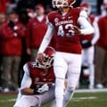 Arkansas sophomore John Henson kicks his first college field goal. Henson replaced Zach Hocker after...