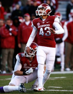 Arkansas sophomore John Henson kicks his first college field goal. Henson replaced Zach Hocker after Hocker missed twice in the first half.