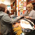 Donna Akers (right), owner of FauxEver Yours in Huntsville, waits on friend and customer Bettinna Co...