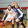 Justyne Huber, left, Prairie Grove, works the ball Saturday near Greenwood's Megan Hartness.