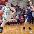 Mackenzie Brown, left, Greenland, drives around Shiloh Christian's Alexis Jones on Saturday in the F...