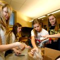 Caroline Holler, from left, Ashton Tate, Maddie Weston and Ali Chapman work to fill bags at Mary Mae...