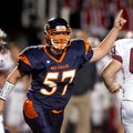 Rogers Heritage defensive lineman Carson Scott celebrates after the defense created a turnover on do...