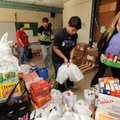 Natalie Counce, right, a junior at Fayetteville High School, and sophomore Nico Suarez, center, help...