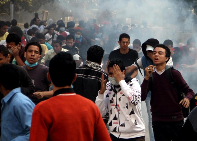 egyptian-protesters-clash-with-security-forces-not-pictured-near-tahrir-square-in-cairo-egypt-sunday-nov-25-2012-president-mohammed-morsi-edicts-which-were-announced-on-thursday-place-him-above-oversight-of-any-kind-including-that-of-the-courts-the-move-has-thrown-egypts-already-troubled-transition-to-democracy-into-further-turmoil-sparking-angry-protests-across-the-country-to-demand-the-decrees-be-immediately-rescinded