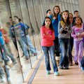 Bellview Elementary School fifth-graders follow along during a tour on Nov. 19 at Crystal Bridges Mu...