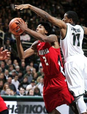 Louisiana-Lafayette guard Elfrid Payton (2) shoots against Michigan State guard Keith Appling (11) during the first half of Sunday's game in East Lansing, Mich. Payton led Louisiana-Lafayette with 20 points, while Appling had 19 for Michigan State. Michigan State won 63-60.