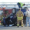 Fayetteville emergency personnel assist while a Hyundai Tucson is righted Sunday after it was involv...