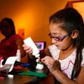 Bethany Flores, 9, of Rogers works on a snowman craft on Sunday inside the Rogers Historical Museum....