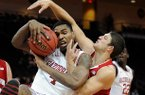 Arkansas' Coty Clarke (4) and Wisconsin's Zak Showalter (33)fight for a rebound during the first half of an NCAA college basketball game at the Continental Tire Las Vegas Invitational tournament on Saturday, Nov. 24, 2012, in Las Vegas. Wisconsin won 77-70. (AP Photo/David Becker)